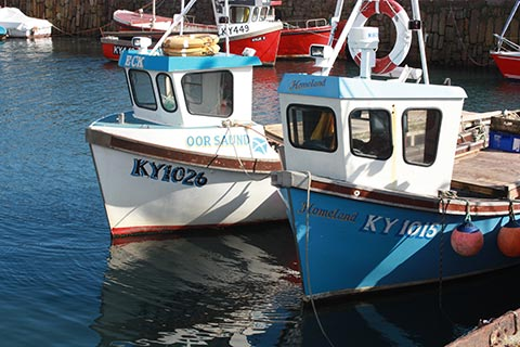 QUAINT FISHING VILLAGES – Boats catch local lobster & crab